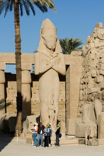 Statue of Rameses II with his daughter, Princess Bint_Anta between his legs, Great Court, Temples of Karnak, Luxor, Nile Valley, Egypt, Africa : Stock Photo