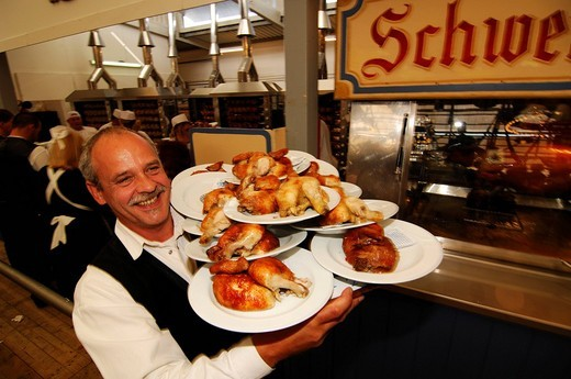 Stock Photo: 1848-219689 Waiter with roast chicken, Wies´n, October fest, Munich, Bavaria, Germany, Europe