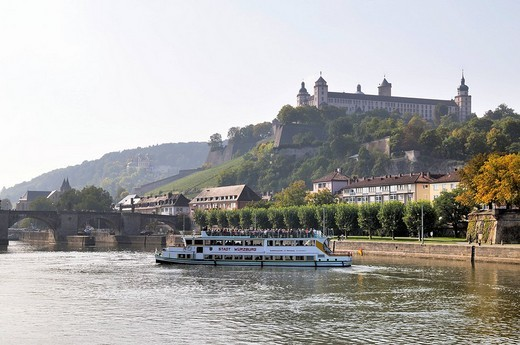 Festung Marienberg fortress, steam_boat on the river Main and Alte Mainbruecke, old bridge across the Main river, Wuerzburg, Franconia, Germany : Stock Photo