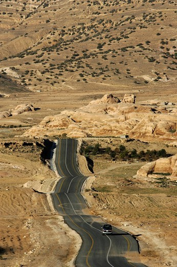 Country road from the Desert Highway to the city of Wadi Musa, Petra, Jordan : Stock Photo
