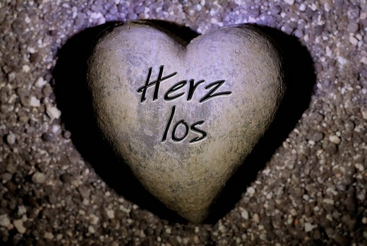 Stock Photo: 1848-221336 Heart with inscription, Herzlos heartless