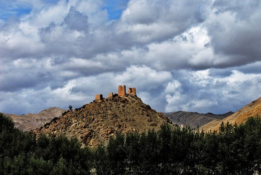 Ruins on barren mountains near Gyantse, Tibet : Stock Photo