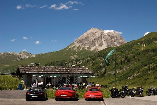 Stock Photo: 1848-221954 Flexen pass at Arlberg Range, sports car in front of cabin, mountains in the back