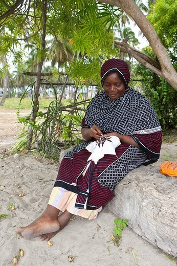 An old woman embroidering a pattern, Jambiani, Zanzibar, Tanzania, Africa : Stock Photo
