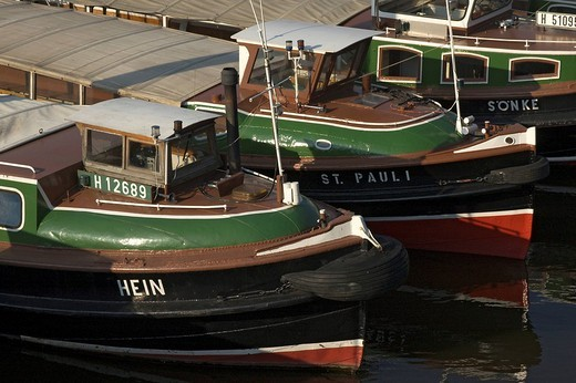 Stock Photo: 1848-222947 Small trip boats ar lying side by side at Hamburg Harbour Germany