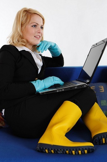 Housewife, working on her laptop : Stock Photo