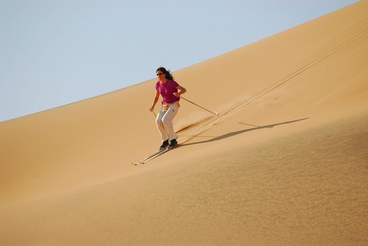 Dune skiing at Sandwich Harbour, Diamond Area, Namibia : Stock Photo