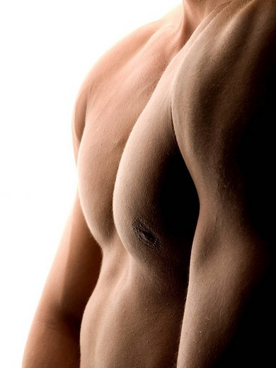 Upper body of a man, naked, back light : Stock Photo
