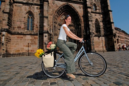 Stock Photo: 1848-225835 Woman goes shopping by bike, city centre of Nuremberg, Franconia, Bavaria, Germany, Europe
