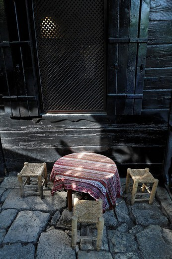 Stock Photo: 1848-226166 Atmospheric seating, a small low table with stools, historic cafe Pierre Loti, Eyuep village, Golden Horn, Istanbul, Turkey