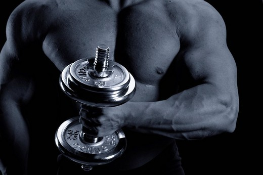 Stock Photo: 1848-226698 Closeup of a bodybuilder training with a weight