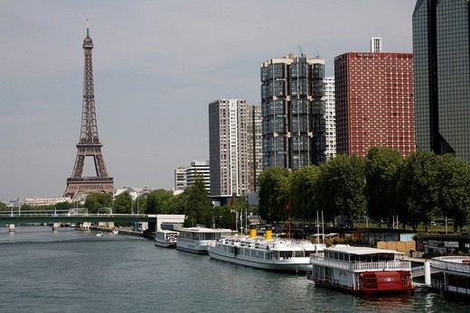 View of the Eiffel Tower, the Seine and office towers at Quai André Citroen in Paris, France, Europe : Stock Photo