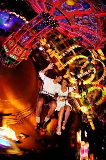Stock Photo: 1848-22773 Oktoberfest Beer Festival, Wies´n, couple on the chairoplane, Munich, Bavaria, Germany, Europe