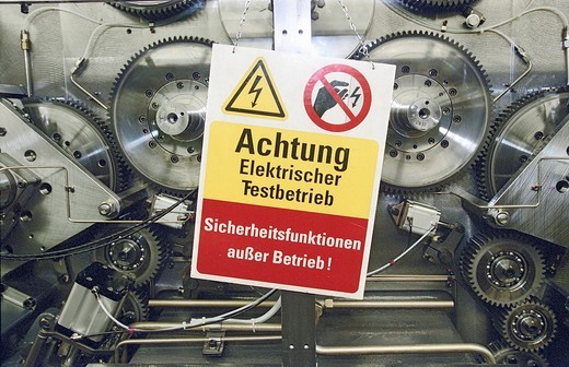 Stock Photo: 1848-228544 MAN Roland _ machine construction Sign: Attention electric testing area