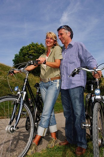Best Agers, bicyclists, bicycle tour, Olympia Center, Munich, Bavaria, Germany, Europe : Stock Photo