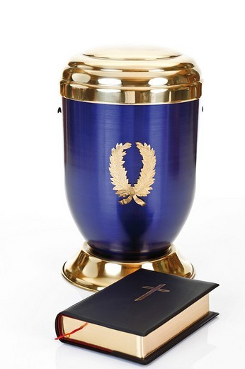Bible in front of a blue urn : Stock Photo