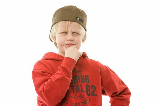 9_year_old boy wearing a cap and red sweater : Stock Photo