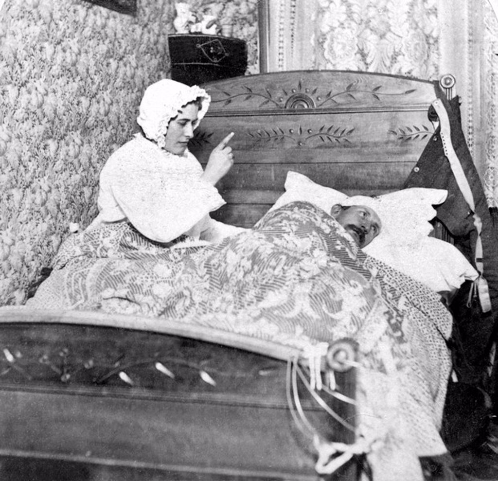 Stock Photo: 1848-22966 Historic photograph, woman scolding her husband in bed, around 1900