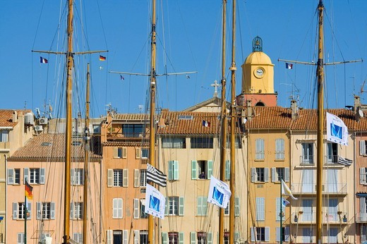 Masts of sailing yachts in front of the houses in the marina of Saint_Tropez during the sailing regatta Les Voiles de Saint_Tropez, Département Var, at the Cote d´Azur, Provence, Southern France, France : Stock Photo