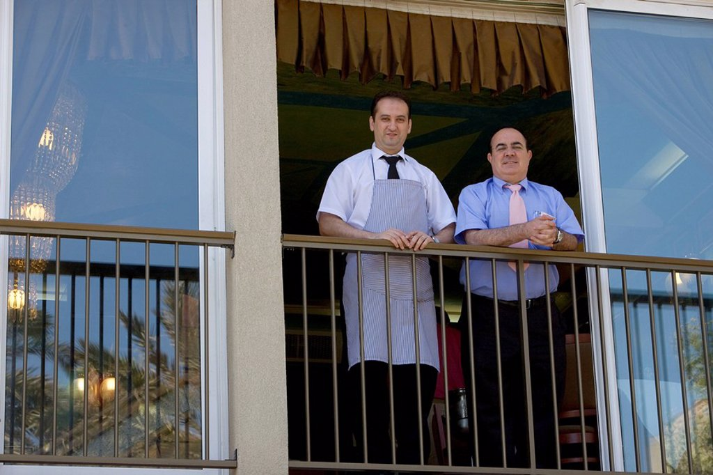 Waiters at the window, Platja Sant Sebastian, Restaurant Salamanca, Barceloneta, Barcelona, Catalonia, Spain : Stock Photo
