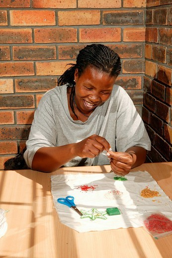 Stock Photo: 1848-230906 Bead embroiderer producing Christmas decorations, Cape Town, South Africa