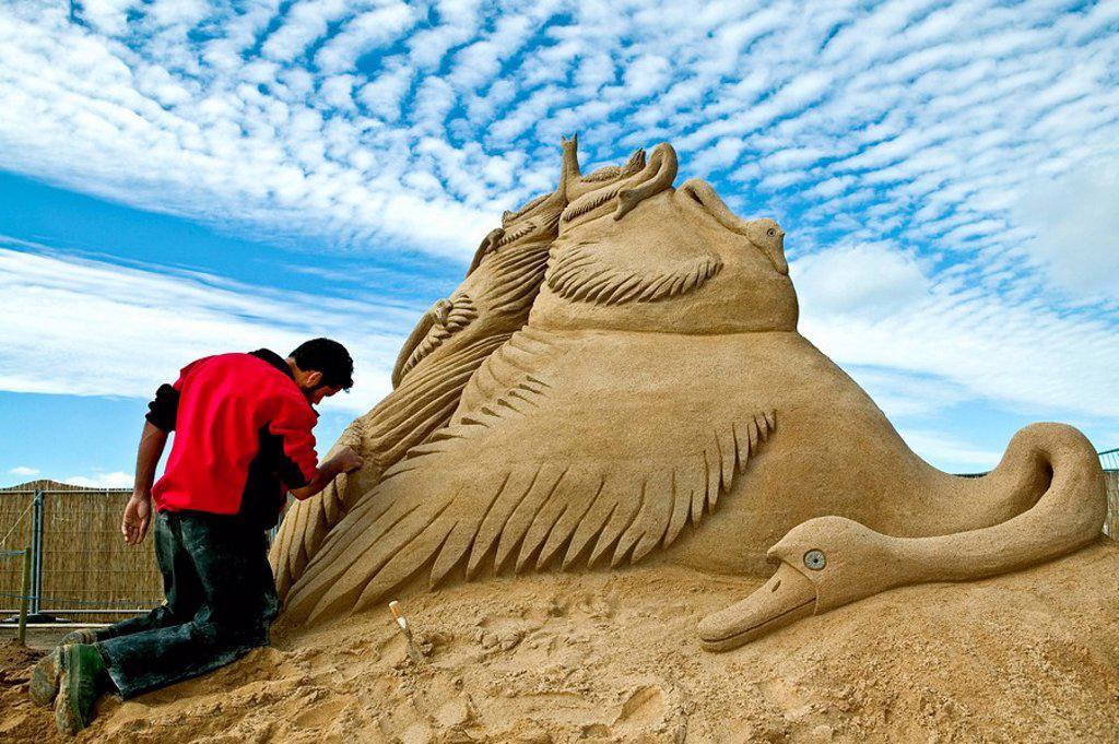 Man creating a sand sculpture : Stock Photo