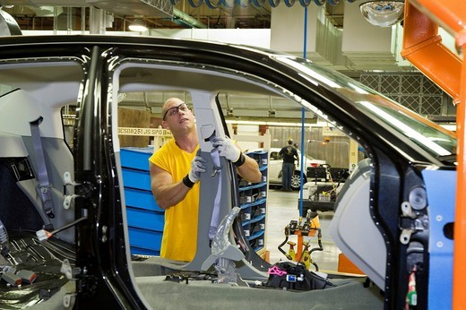 Stock Photo: 1848-233843 A member of the United Auto Workers union assembles the Chrysler Sebring sedan at Chrysler´s Sterling Heights Assembly Plant, here a worker installs a seat belt module, Sterling Heights, Michigan, USA