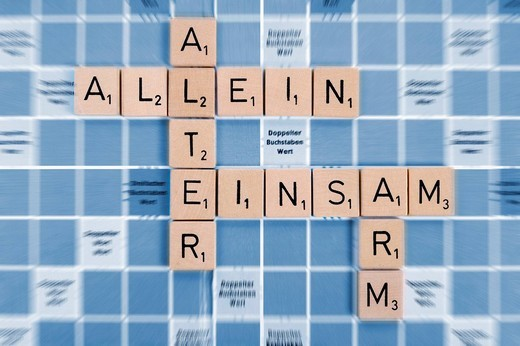 The words Alter, allein, einsam and arm, German for age, alone, lonely and poor, composed of tiles, symbolic image for old_age poverty : Stock Photo