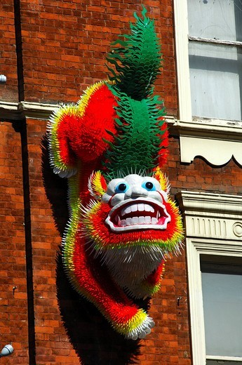 Dragon figure at the entrance to Chinatown, London, UK, Europe : Stock Photo