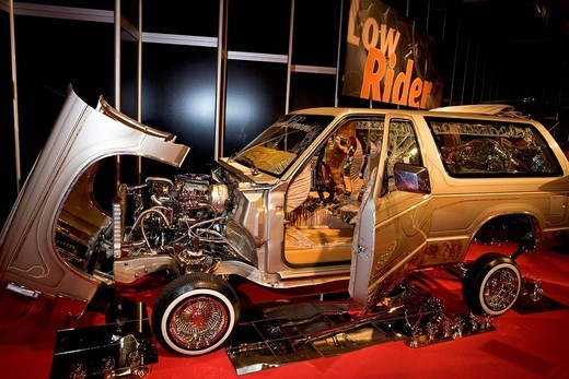 Gilded low rider show car, exhibit at Essen Motor Show, NRW, Germany : Stock Photo