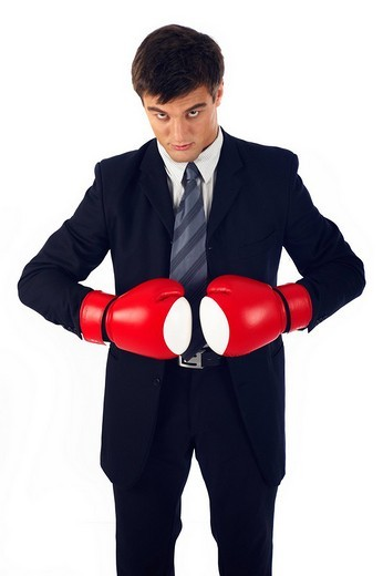 Businessman wearing boxing gloves : Stock Photo