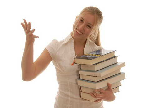 Eighteen year old woman with books, laughing, fun learning : Stock Photo
