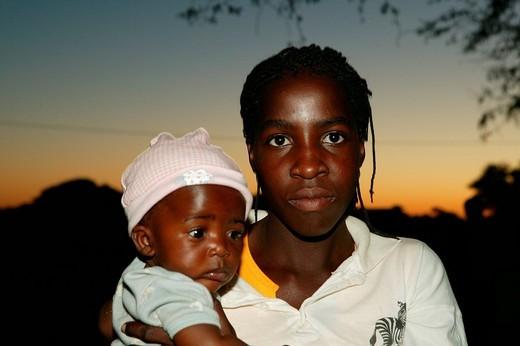Stock Photo: 1848-237029 Mother with child, Sehitwa, Botswana, Africa