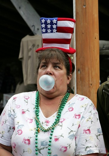 Stock Photo: 1848-237147 Bubblegum blowing competition during Fourth of July celebrations Independence Day in Gustavus: population 400, Alaska, USA, North America