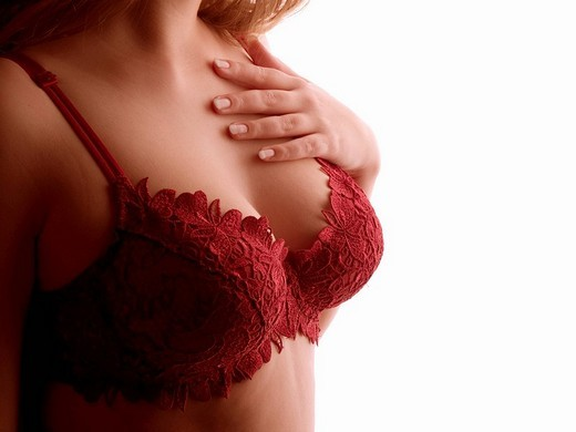 Stock Photo: 1848-237162 Curvaceousness, woman wearing bra, hand touching her chest
