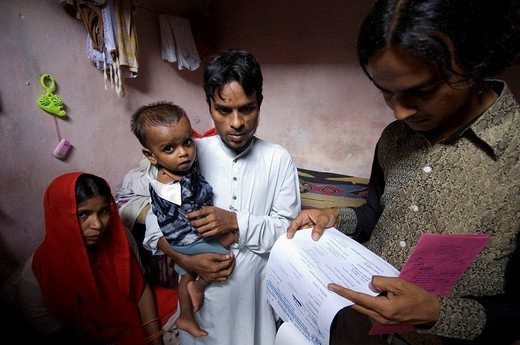Stock Photo: 1848-237375 With Fahim, right, a social worker, on a house visit in the Muslim slums. In this family there was a problem with the treatment of the small child. The medical supply is financed by aid organizations. In addition however special criteria, e.g. extreme pov
