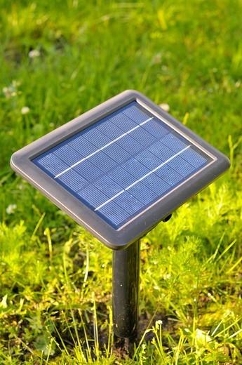 Solar module in the garden : Stock Photo