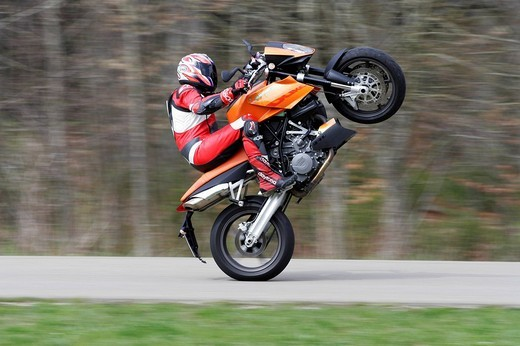 KTM Super Duke, Wheelie : Stock Photo