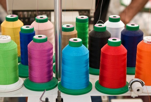 Spools of colorful embroidering threads : Stock Photo