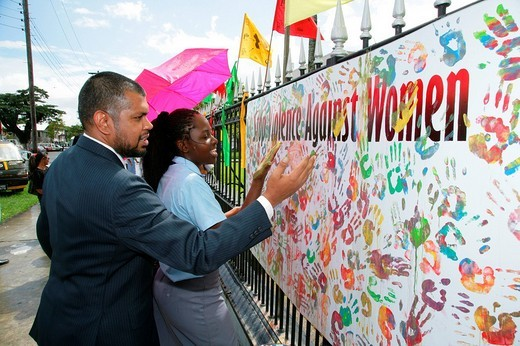 Stock Photo: 1848-24272 Multi_coloured handprints as a symbol of cooperation between people of various ethnic backgrounds during a protest against violence against women in Georgetown, Guyana, South America