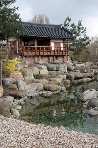 Kye Zeong Pavilion, garden pavilion next to water in the Korean Seoul Garden, Gaerten der Welt, Gardens of the World, Berlin Marzahn, Germany, Europe : Stock Photo