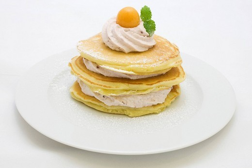 Stock Photo: 1848-243709 American buttermilk pancakes filled with wood berry cream, decorated with cape gooseberries and lemon balm