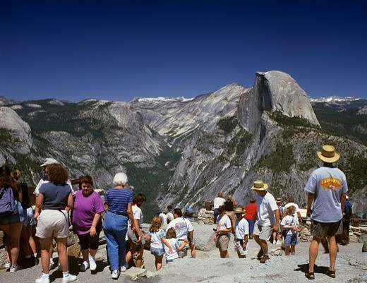Stock Photo: 1848-244375 Tourist enjoy the view to the Half Dome viewed from Glacier Point, Yosemite NP, California, USA
