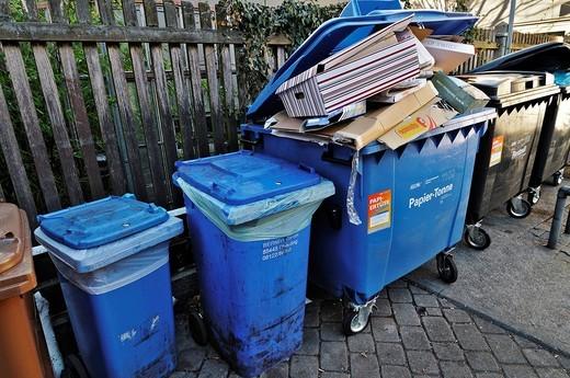 Paper recycling bins, courtyard near Tuerkenstrasse, Munich, Bavaria, Germany : Stock Photo