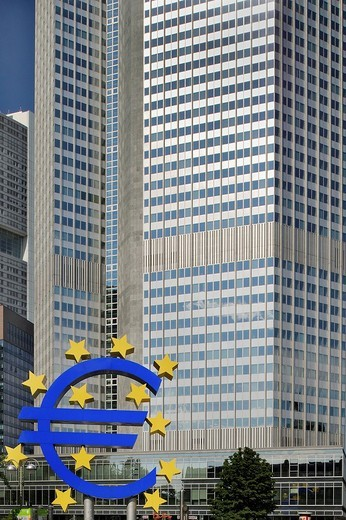 Office tower of the European Central bank or ECB, behind a blue Euro symbol surrounded by 12 yellow stars, Frankfurt, Hesse, Germany, Europe : Stock Photo