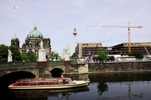 Demolition work at the Palace of the Republic Palast der Republik in the background TV tower, in the foreground river Spree with excursion boat Berlin Germany : Stock Photo