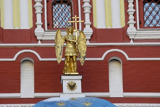 Stock Photo: 1848-247790 Statue of the golden angel holding an Orthodox cross on the dome of the Iveron chapel, Manezhnaya square, Moscow, Russia