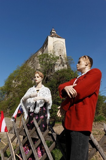 Dolls in traditional costume in front of Raabs Castle on Thaya, Waldviertel, Lower Austria, Austria, Europe : Stock Photo