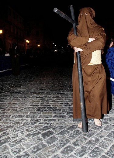 Stock Photo: 1848-249287 Bare_footed penitent bearing a cross, Semana Santa procession, Holy Week, Huelva, Andalusia, Spain
