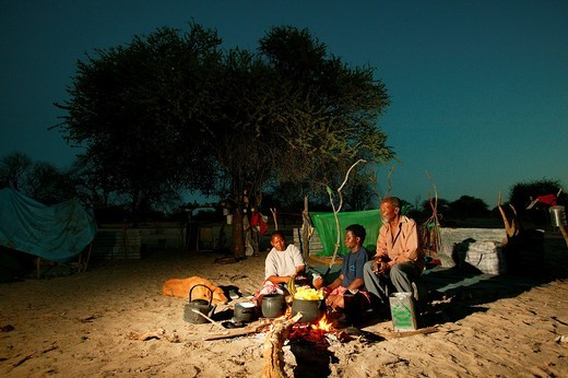 Two women cooking at the campfire, Cattlepost Bothatogo, Botswana, Africa : Stock Photo